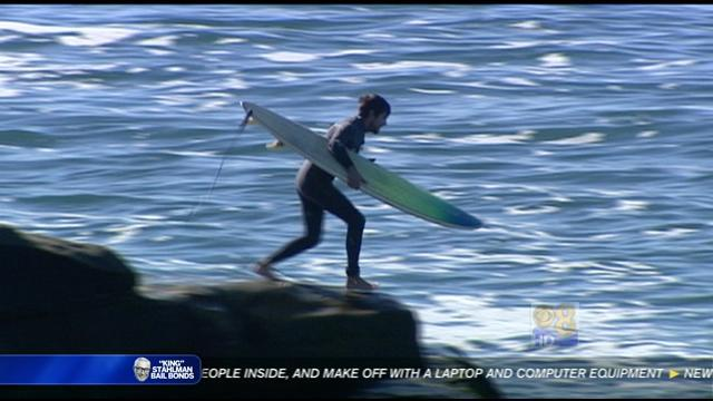 High surf makes just getting in and out of water a challenge
