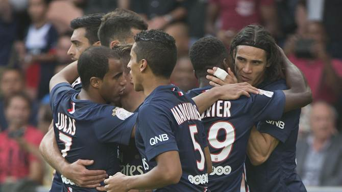 Paris Saint Germain's Edinson Cavani, right, celebrates his second goal with teammates during a French League One soccer Match Paris Saint Germain against Bastia, at Parc des Princes stadium, in Paris, Saturday, Aug. 16. 2014. Paris Saint Germain won 2-0. (AP Photo/Michel Euler)