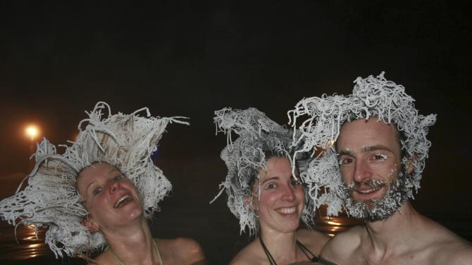 Handout of bathers showing off frozen hair while bathing in a 40 C pool in air temperatures of -30 C at Takhini Hot Springs in Whitehorse
