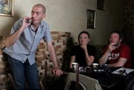 People smoke in a restaurant in Moscow in May 2008. President Vladimir Putin signed a law banning smoking in public places in Russia from June, a cornerstone of the government's bid to improve public health, the Kremlin said Monday