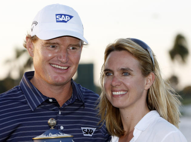 File - in this Sunday, March 14, 2010 file photo. Ernie Els and his wife Lieztl pose for photographers during the trophy ceremony at the CA Championship golf tournament in Doral, Fla. Els says he is c