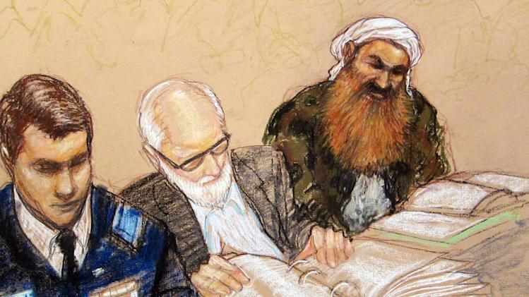 In this pool photo of a sketch by courtroom artist Janet Hamlin and reviewed by the U.S. Department of Defense, the self-proclaimed terrorist mastermind Khalid Sheikh Mohammed, right, reviews court documents with his lawyers during the pre-trial hearing of the death penalty case against the five Sept. 11 attack suspects at the Guantanamo Bay U.S. Naval Base in Cuba, Tuesday, Feb. 12, 2013. U.S. Navy Capt. Thomas Welsh, a senior official for the Guantanamo Bay prison said under questioning Tuesday that the government had placed a hidden microphone inside a meeting room but that he was assured it was not used to monitor the private conversations that prisoners have with their lawyers and the Red Cross. (AP Photo/Janet Hamlin, Pool)