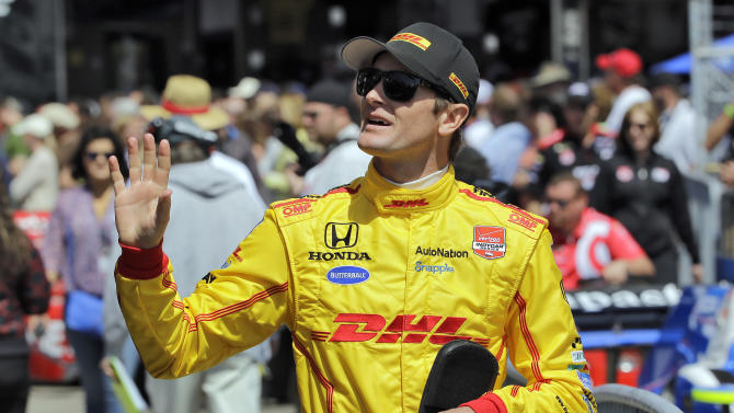 Driver Ryan Hunter-Reay waves to fans as he walks to his car before practice for the IndyCar Firestone Grand Prix of St. Petersburg auto race Saturday, March 28, 2015, in St. Petersburg, Fla. The race takes place on Sunday. (AP Photo/Chris O'Meara)