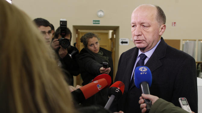 Lithuania's Prime Minister, Homeland Union leader Andrius Kubilius speaks to media at a polling station in Vilnius, Lithuania, Sunday, Oct. 28, 2012. Lithuanians voted Sunday in a second round of parliamentary elections.  (AP Photo/Mindaugas Kulbis)