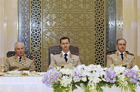 Syria's President al-Assad attends a dinner on 65th Army Foundation anniversary in Damascus