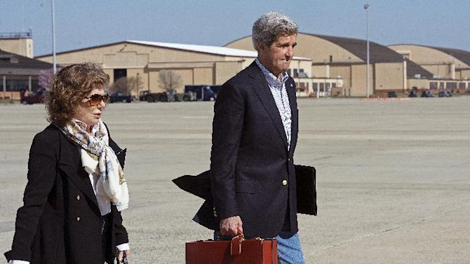 U.S. Secretary of State John Kerry and his wife Teresa Heinz Kerry board a second plane after their original aircraft had mechanical problems on April 6, 2013, at Andrews Air Force Base in Maryland. Kerry heads to the Middle East, his third trip to the region in two weeks, in a fresh bid to unlock long-stalled Israeli-Palestinian peace talks. And in Istanbul, the first leg of a six-nation trip that goes on to Europe and East Asia, Kerry will coordinate with Turkey's Prime Minister and other Turkish officials on efforts to halt the violence in neighboring Syria's civil war.  (AP Photo/Paul J. Richards, Pool)