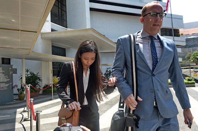 Former girlfriend Shirley Sarmiento and former neighbour Michael William Goodwin of US scientist Shane Todd leave the Subordinate courts in Singapore, on May 13, 2013. The scientist whose family claims he was murdered was under treatment for depression and left suicide notes before he was found hanged, a public inquiry was told on Monday