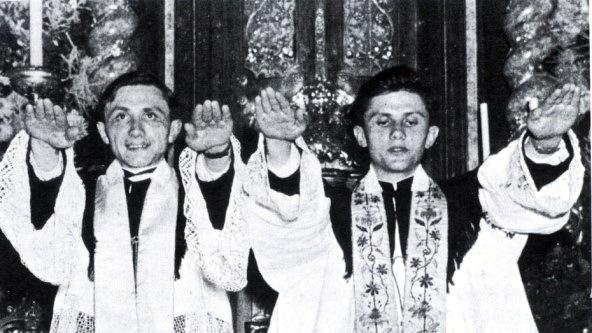 FILE - In this June 29, 1951 file photo, Joseph Ratzinger, right, and his brother Georg after their ordination to priesthood in Freising, southern Germany. Ratzinger, who later became Pope Benedict XVI, announced Monday, Feb. 11, 2013 that he will resign on Feb. 28. The 85-year-old pope announced his decision in Latin during a meeting of Vatican cardinals. (AP Photo/dpa, Archdiocese Munich, File)
