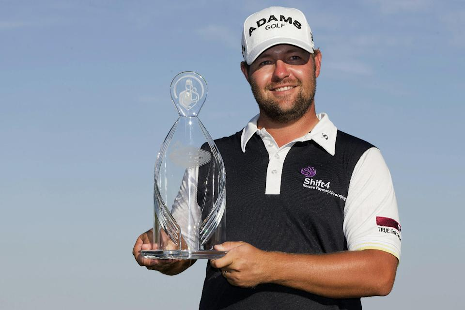 Ryan Moore holds up the trophy after winning the Justin Timberlake Shriners Hospitals for Children Open golf tournament, Sunday, Oct. 7, 2012, in Las Vegas. Moore finished with a 5-under 66 for a one-stroke victory over Brendon de Jonge. (AP Photo/Julie Jacobson)