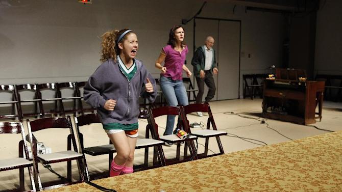 """This theater image released by Richard Kornberg & Associates shows, from left, Lisa Joyce, Christina Rouner and Michael Rudko, in a scene from Transport Group's production of Jonathan Franzen's """"House for Sale,"""" performing off-Broadway at The Duke Theater in New York.  (AP Photo/Kornberg & Associates, Carol Rosegg)"""