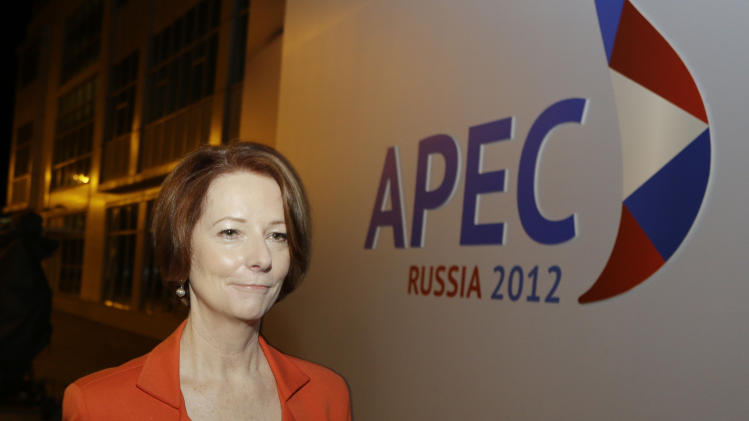 Australian Prime Minister Julia Gillard walks to her car following a press conference at the APEC summit in Vladivostok, Russia, Friday, Sept. 7, 2012. (AP Photo/Mark Baker)