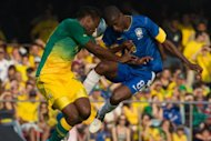 Brazil's Ramires (R) vies for the ball with South Africa's Khumalo during their friendly football match at Morumbi stadium in Sao Paulo, Brazil. Brazil won 1-0 over South Africa