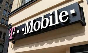 Signage for a T-Mobile store is pictured in downtown Los Angeles, California
