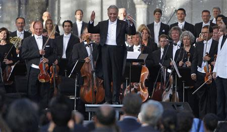 Bavarian State Orchestra and renowned conductor Mehta gestures before performing at the Ehasas-e-Kashmir concert at Shalimar Garden on the outskirts of Srinagar