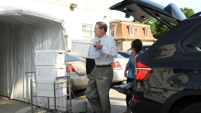 Attorney for Jerry Sandusky, Joe Amendola loads boxes onto a cart after arriving for the fourth day of Sandusky's trial at the Centre County Courthouse in Bellefonte, Pa., Thursday, June 14, 2012.  Sandusky faces 52 counts of child sex-abuse  involving 10 boys over a 15-year span.  (AP Photo/Centre Daily Times, Nabil K. Mark)