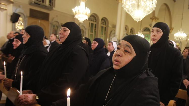 Nuns who were freed after being held by rebels for over three months, are seen attending a prayer of thanks after their release, at the Holy Cross Church, in Damascus