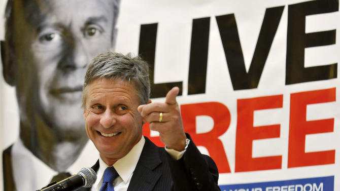 FILE - In this Wednesday, Dec. 28, 2011 file photo, former New Mexico Gov. Gary Johnson speaks at a news conference during which he announced he is leaving the Republican Party in favor of seeking a presidential nomination as a Libertarian, at the State Capitol in Santa Fe, N.M. Something's going on in America this election year: a renaissance of an ideal as old as the nation itself - that live-and-let-live, get-out-of-my-business, individualism vs. paternalism dogma that is the hallmark of libertarianism. But what looms are far larger questions about whether an America fed up with government bans and government bailouts - with government, period - is seeing a return to its libertarian roots. (AP Photo/Albuquerque Journal, Eddie Moore, File)