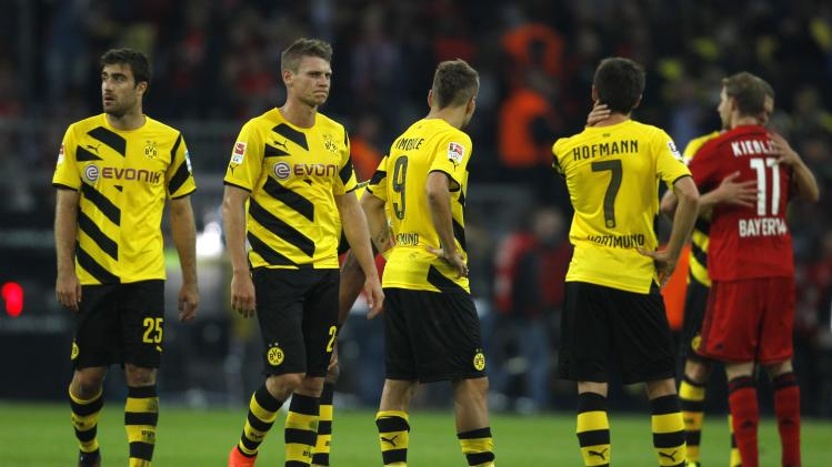 Borussia Dortmund players react after the German first division Bundesliga soccer match against Bayer Leverkusen in Dortmund