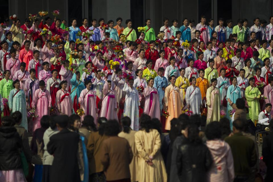 A North Korean choir performs on the steps of a public building in Pyongyang, North Korea Wednesday, April 11, 2012. (AP Photo/David Guttenfelder)