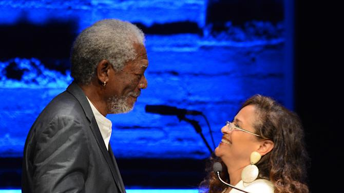 EXCLUSIVE CONTENT - Morgan Freeman, left, and Debbie Allen speak on stage during the Backstage at the Geffen gala at the Geffen Playhouse on Monday, May 13, 2013, in Los Angeles. (Photo by Jordan Strauss/Invision for Geffen/AP Images)