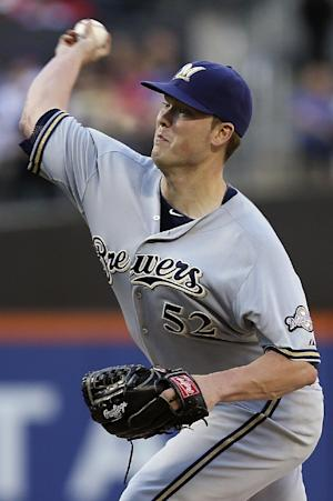 Carlos Gomez leads Brewers past Mets 4-2 in 10