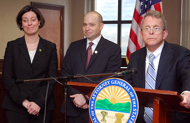 Ohio Attorney General Mike DeWine, right, answers questions about the successful prosecution of two juveniles in a rape case during a news conference Sunday, March 17, 2013, at the Jefferson County Justice Center in Steubenville, Ohio. Prosecutor Marianne Hemmeter and Prosecutor Brian Deckert joined DeWine. Judge Thomas Lipps ruled Sunday that Steubenville High School students Trent Mays, 17, and Ma'Lik Richmond, 16, were guilty of raping a 16-year-old Weirton, W.Va., girl after an alcohol-fueled party in August 2012. (AP Photo/Steubenville Herald-Star, Michael D. McElwain, Pool)
