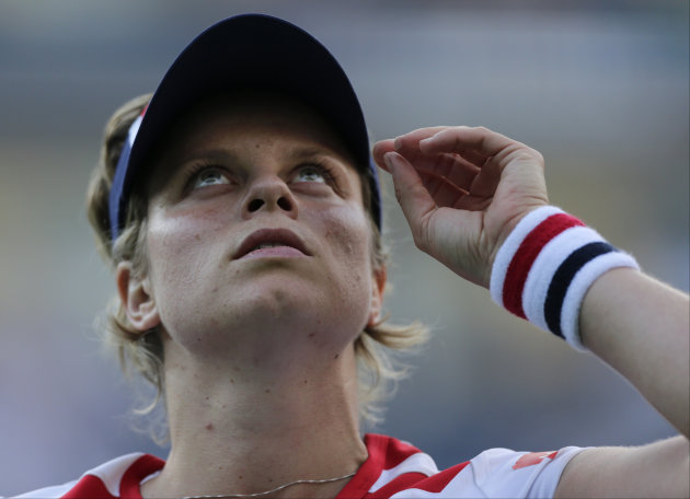 Kim Clijsters of Belgium looks up after losing to Laura Robson of Great Britain in the second round of play at the 2012 US Open tennis tournament, Wednesday, Aug. 29, 2012, in New York. (AP Photo/Charles Krupa)