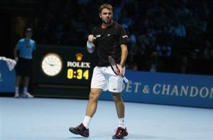 Wawrinka celebrates breaking serve against Berdych at ATP World Tour Finals in London
