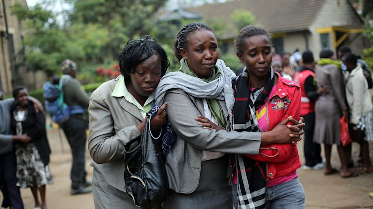 Relatives of Johnny Mutinda Musango, 48, weep after identifying his body at the city morgue in Nairobi, Kenya, Tuesday Sept. 24 2013. Musango was one of the victims of the Westgate Mall hostage siege. Kenyan security forces were still combing the Mall on the fourth day of the siege by al-Qaida-linked terrorists. (AP Photo/ Jerome Delay)