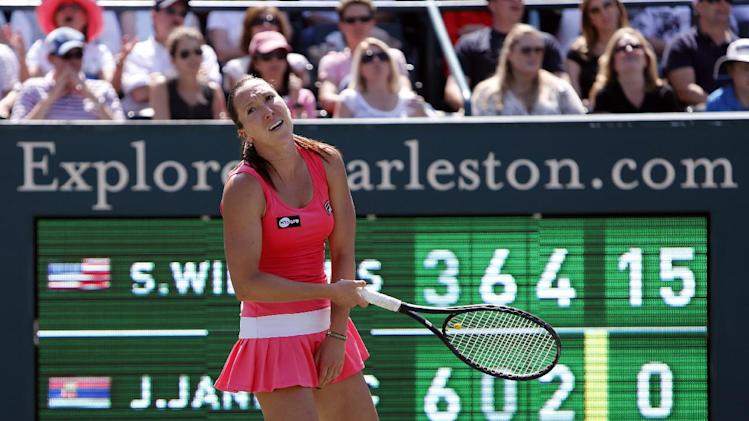Jelena Jankovic, of Serbia, reacts after a bad shot to Serena Williams during the singles final at the Family Circle Cup tennis tournament in Charleston, S.C., Sunday  April 7, 2013.  Williams defeated Jankovic 3-6, 6-0, 6-2, to win the Family Circle Cup. (AP Photo/Mic Smith)