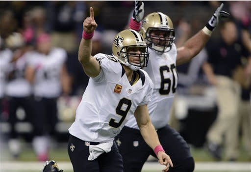 Brees sets mark, Saints beat Chargers 31-24