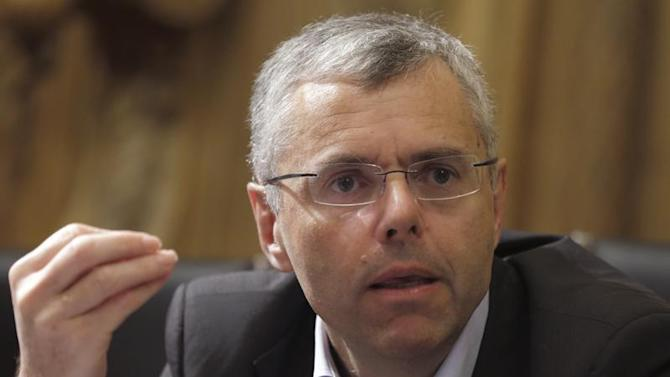 Michel Combes, Telecom equipment maker Alcatel-Lucent Chief Executive Officer, speaks during an interview with Reuters in Paris