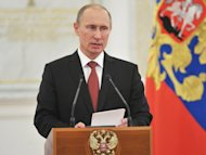 Russia's President Vladimir Putin speaks at the Kremlin in Moscow on December 28, 2012. Putin has used a traditional New Year address to call for unity following a year of protests against his return to the Kremlin for a third term
