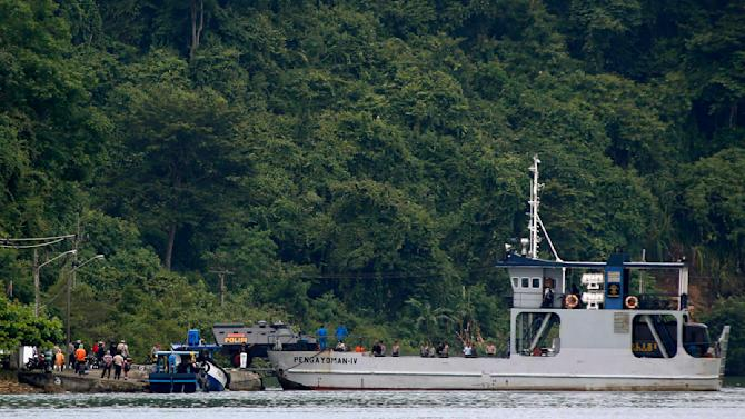 An armoured police vehicle carrying one of two Australian prisoners is unloaded from a ferry on the prison island of  Nusa Kambangan where upcoming executions are expected to take place, in Cilacap, Central Java