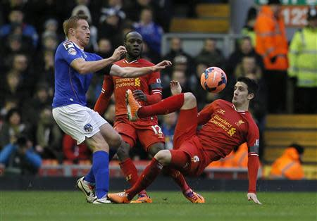 Oldham Athletic's Rooney challenges Liverpool's Alberto during their FA Cup third round soccer match at Anfield in Liverpool