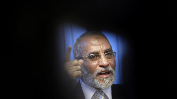 """FILE - In this Tuesday, Oct. 26, 2010 file photo, Muslim Brotherhood General Guide Mohammed Badie talks during an interview with the Associated Press at his office in Cairo Egypt. A leading Jewish organization is calling Saturday, Oct. 13, 2012 on the White House to cut contacts with Egypt's most powerful political movement, the Muslim Brotherhood, over anti-Semitic remarks attributed to its spiritual guide. Mohammed Badie said that Jews were spreading """"corruption,"""" had slaughtered Muslims and profaned holy sites, according to comments published on the group's website and emailed to reporters. He further called on Muslims to fight Israel, saying Zionists only understood force.(AP Photo/Amr Nabil, File)"""