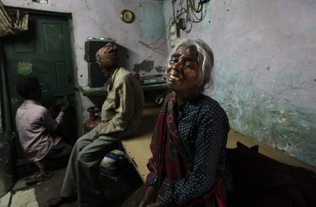 The mother of Ram Singh, the man accused of driving the bus on which a 23-year-old student was gang raped in December 2012, cries as she speaks to journalists inside the family's home in New Delhi, In
