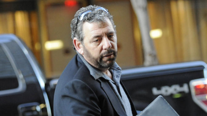 New York Knicks owner James  Dolan arrives at a midtown hotel where NBA labor talks are scheduled to resume, Saturday, Nov. 5, 2011, in New York. (AP Photo/ Louis Lanzano)