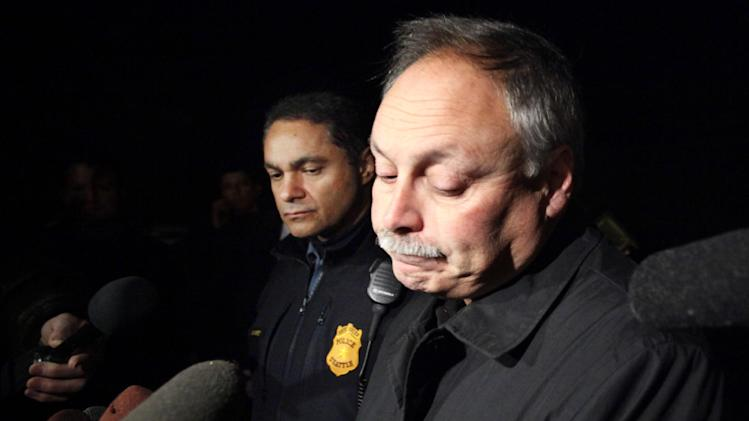 File-This Dec. 1, 2011 file photo shows Seattle Police chief John Diaz, right, during a news briefing with assistant chief Nick Metz, left, in Seattle. Diaz retired Monday, April 8, 2013 as his department faces a court order involving use of force by officers. (AP Photo/Elaine Thompson,File)