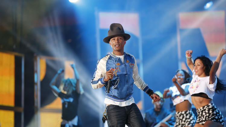 "FILE - In this Feb. 16, 2014 file photo, Pharrell Williams rehearses before the NBA All Star basketball game in New Orleans. The producer-rapper-singer's tune ""Happy"" is nominated for best original song at the Oscars on Sunday, March 2, 2014. Days ahead, the upbeat anthem has climbed to No. 1 on the Billboard Hot 100 chart. (AP Photo/Bill Haber)"