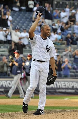 New York Yankees' Mariano Rivera tips his cap to acknowledge the cheers of the crowd after recording his 602nd save as the Yankees beat the Minnesota Twins 6-4 in a baseball game on Monday, Sept. 19, 2011, at Yankee Stadium in New York. (AP Photo/Kathy Kmonicek)