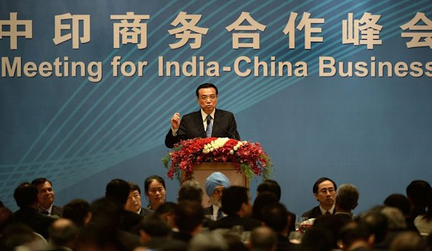 Li Keqiang, PM of the People's Republic of China, addresses a business summit in Mumbai on May 21, 2013