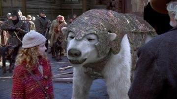 Dakota Blue Richards as Lyra, and Iorek Byrnison (voiced by Ian McKellen ) in New Line Cinema's The Golden Compass