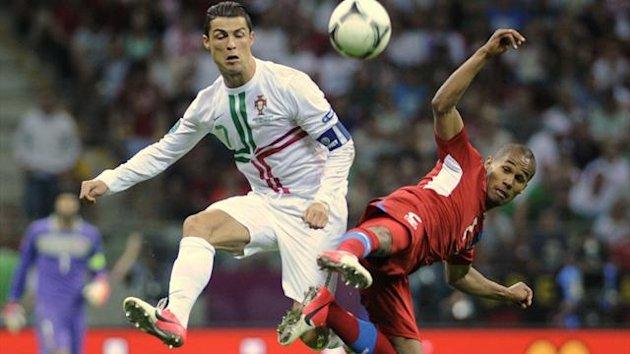 Portugal's Cristiano Ronaldo and Czech Republic's Theodor Gebre Selassie fight for the ball