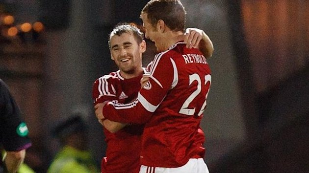 Niall McGinn's, left, penalty for Aberdeen was enough to relegate Dundee