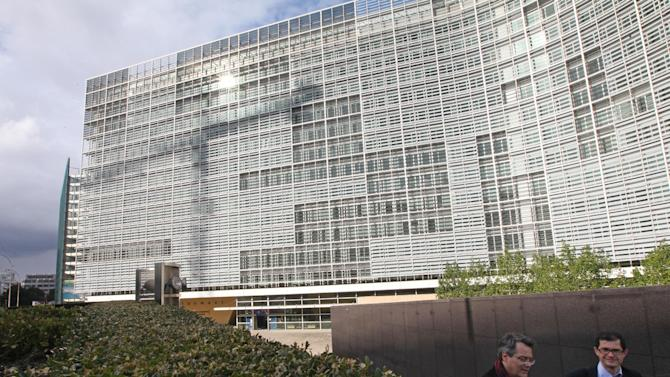 People walk past the European Commission headquarters, after the 2012 Nobel Peace Prize was awarded to the EU, at the European Commission headquarters in Brussels, Friday, Oct. 12, 2012. The European Union won the Nobel Peace Prize on Friday for its efforts to promote peace and democracy in Europe, despite being in the midst of its biggest crisis since the bloc was created in the 1950s. (AP Photo/Yves Logghe)