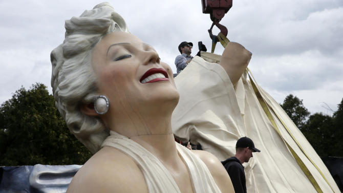 """Workers prepare to lift parts of a 26-foot-tall, 34,000-pound statue named """"Forever Marilyn"""" in Hamilton, N.J., Tuesday, April 8, 2014. The sculpture depicting Marilyn Monroe in her memorable billowing skirt pose from the """"The Seven Year Itch"""" is part of an exhibit honoring its designer, Seward Johnson. (AP Photo/Mel Evans)"""