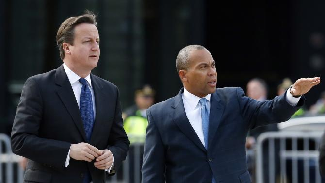 British Prime Minister David Cameron, left, and Massachusetts Gov. Deval Patrick arrive for a visit at the makeshift memorial to the Boston Marathon bombing victims in Copley Square in Boston, Tuesday, May 14, 2013. Cameron is in Boston to offer his condolences and discuss lessons that can be learned from the deadly bombings. (AP Photo/Michael Dwyer)