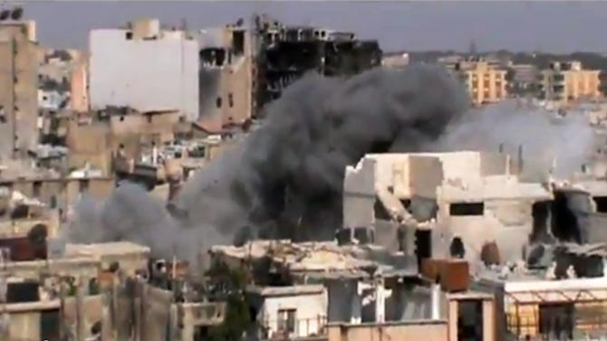 This image made from amateur video released by Shaam News Network and accessed by the Associated Press Saturday, July 21, 2012 purports to show shelling of Homs, Syria by government forces on July 21, 2012. (AP Photo/Shaam News Network via AP video) IMAGE MADE FROM AMATEUR VIDEO RELEASED BY SHAAM NEWS NETWORK AND ACCESSED VIA AP VIDEO SATURDAY, JULY 21, 2012. THE ASSOCIATED PRESS CANNOT INDEPENDENTLY VERIFY THE CONTENT, DATE, LOCATION OR AUTHENTICITY OF THIS MATERIAL