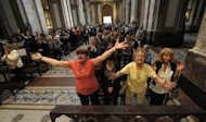 <p>Catholics react at Metropolitan Cathedral in Buenos Aires after the announcement that Buenos Aires archbishop Jorge Mario Bergoglio was elected Pope Francis, March 13, 2013.</p>